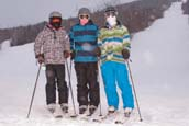 3 Skiers in the Snow